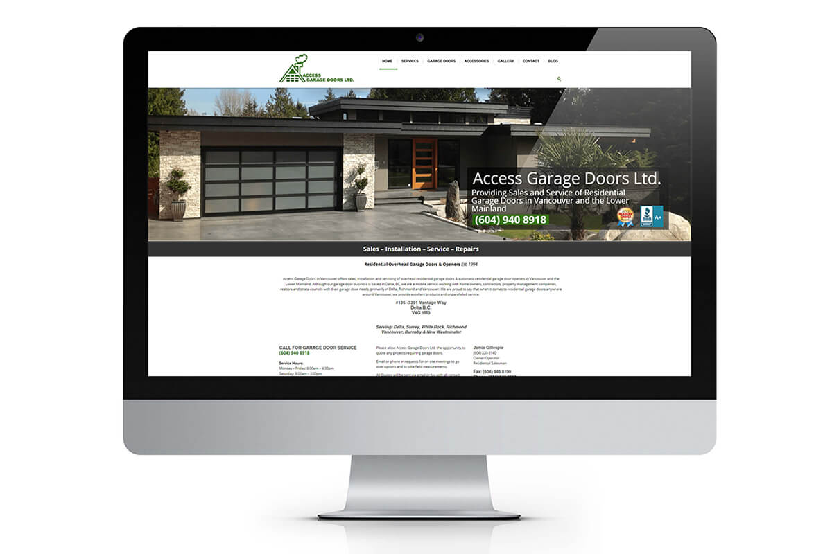 Access Garage Doors homepage displayed on imac computer