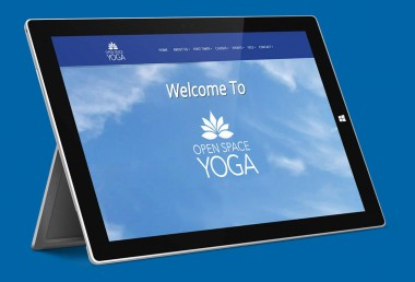 Open Space Yoga website on a surface pro